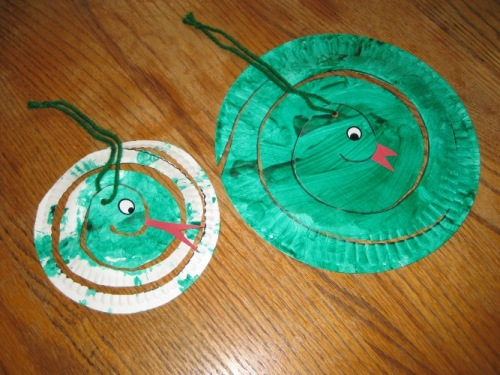 Paint a paper plate all green. When dry draw a spiral and help the children cut on the line. Add eyes and tongue and hang from the ceiling. & Letter \